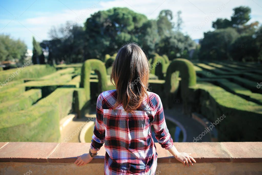 young woman relax in the park labyrinth in Barcelona