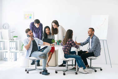 Young business people or students work in team indoor