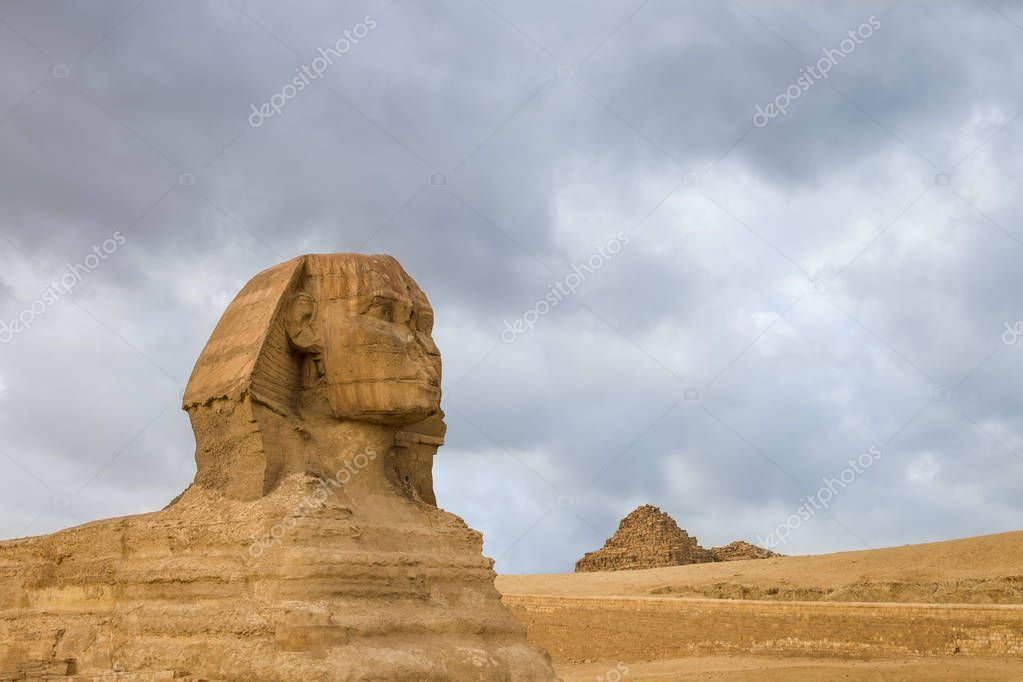 Great Sphinx profile wih pyramids on background in Giza, Cairo, Egypt. Travel background. Architectural monument.