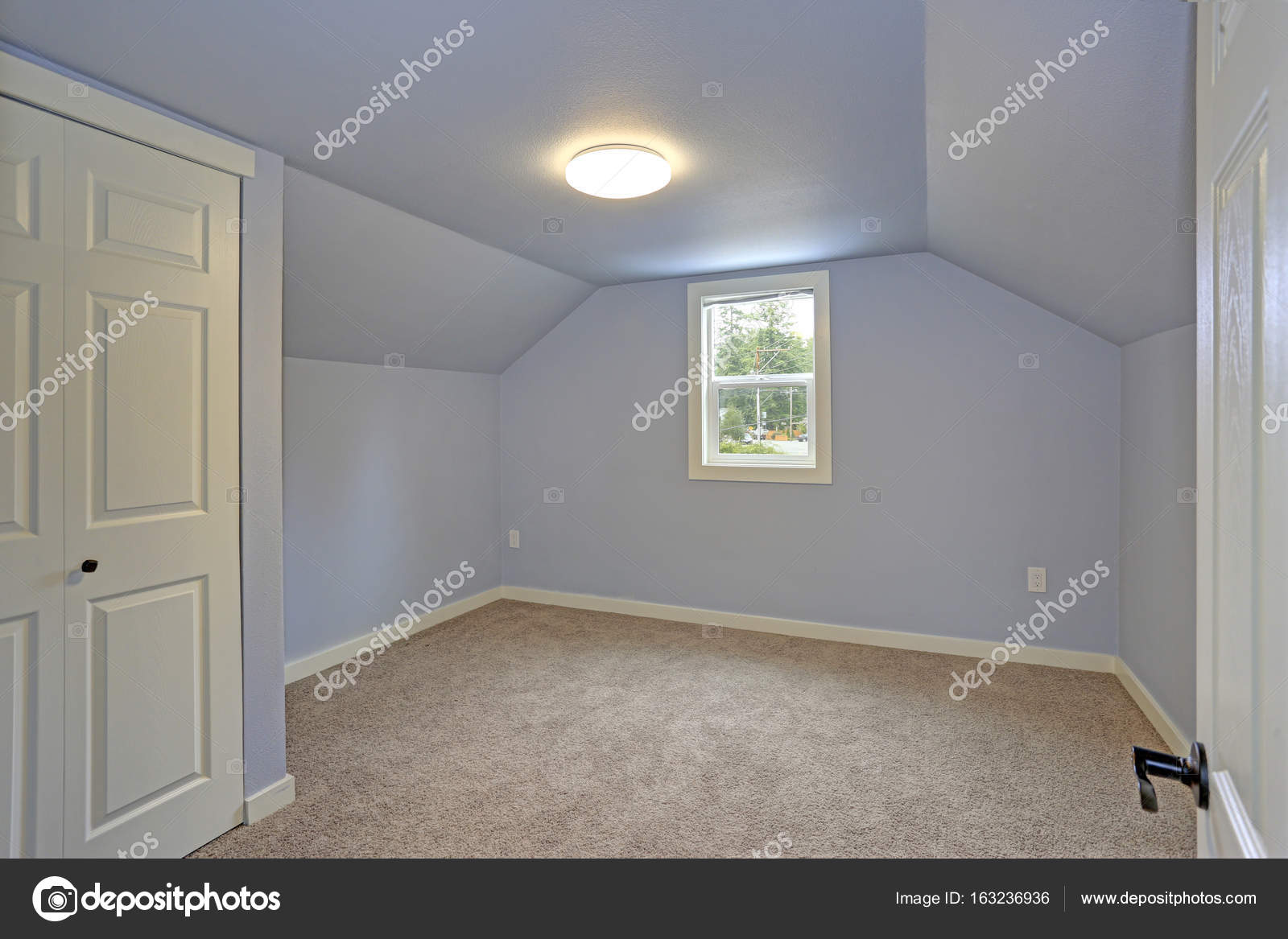 Small Empty Blue Bedroom Accented With Vaulted Ceiling Stock Photo Image By C Alabn 163236936