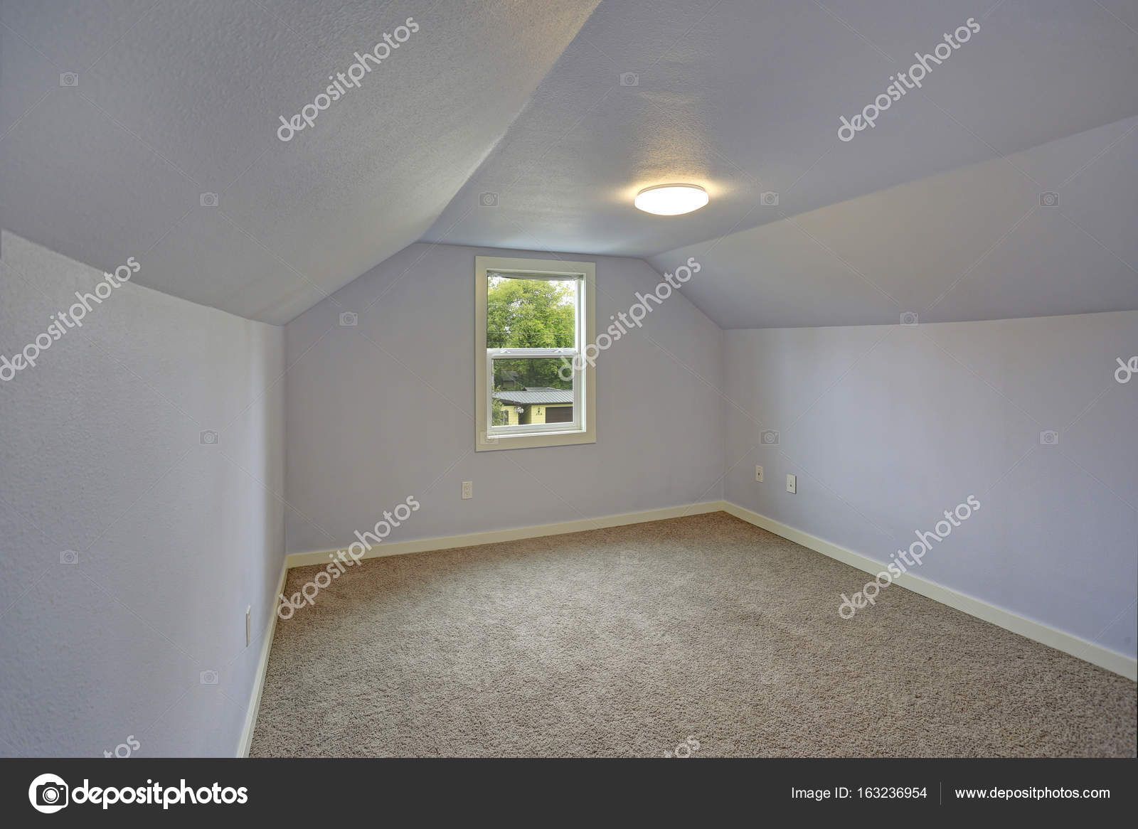 Small Empty Blue Bedroom Accented With Vaulted Ceiling Stock Photo Image By C Alabn 163236954