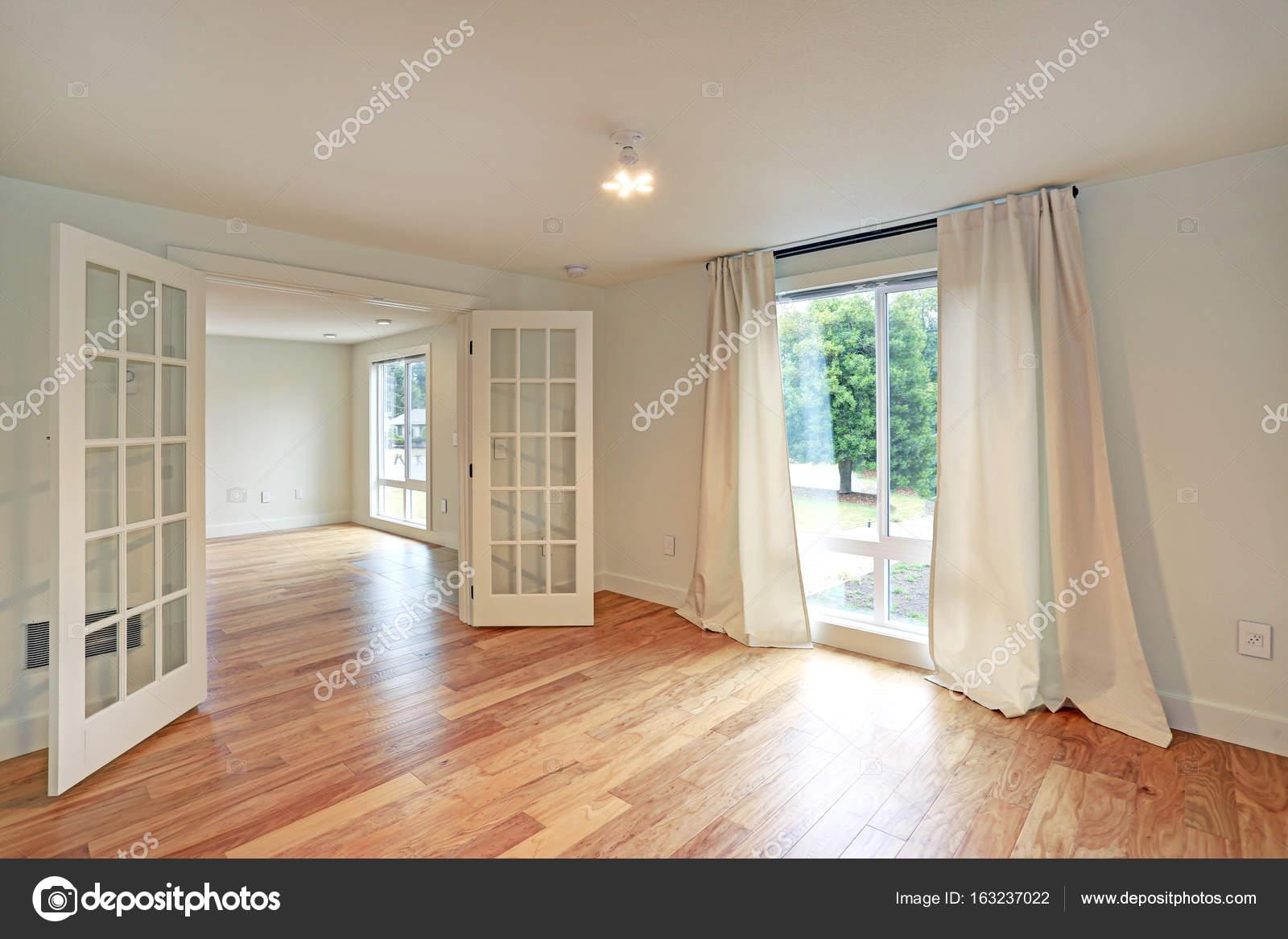 light and bright empty family room interior stock photo alabn rh depositphotos com Laundry Room Empty Creepy Empty Room