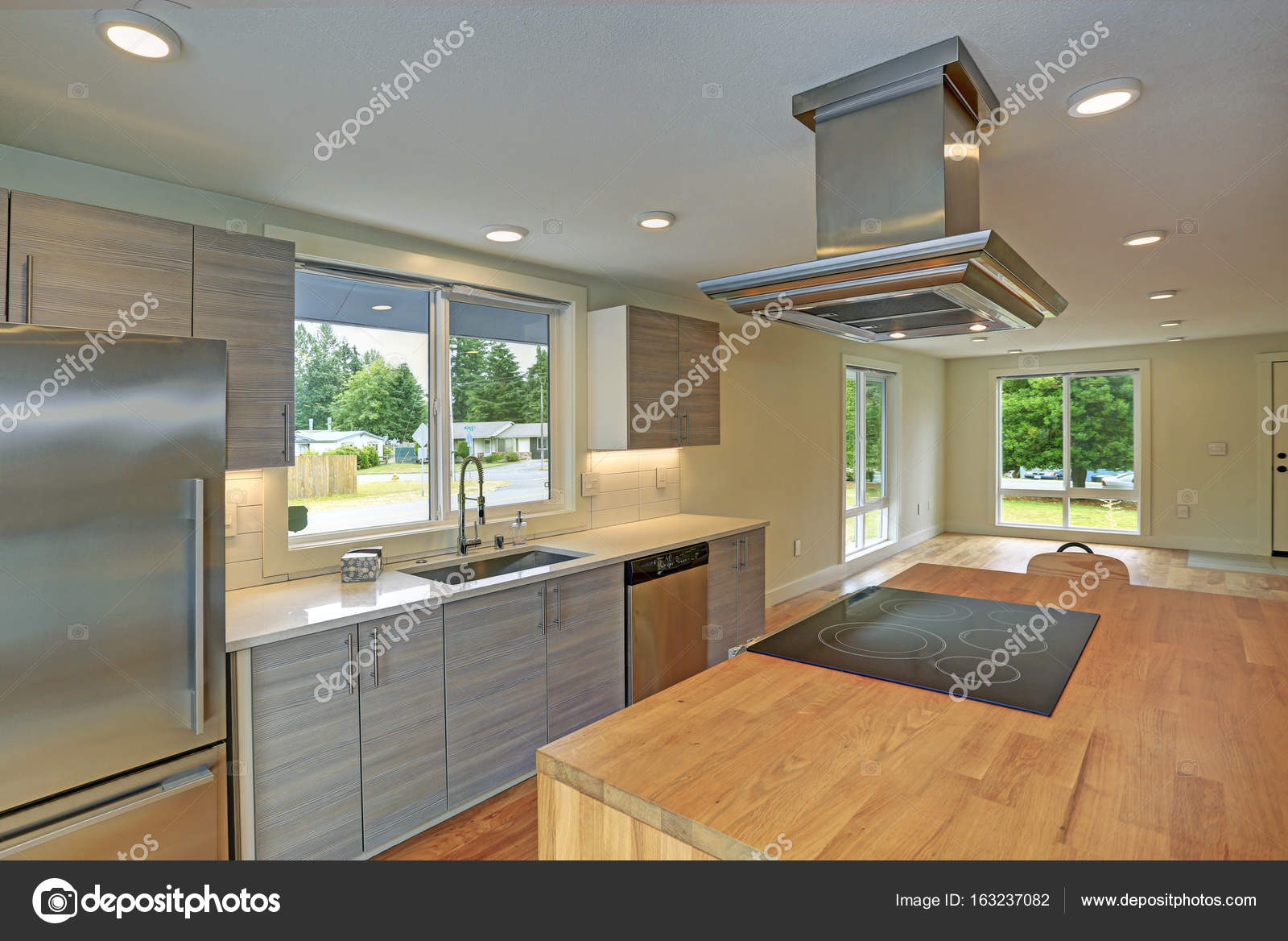 newly remodeled kitchen boasts kitchen island with a hood stock photo 163237082 - Newly Remodeled Kitchens