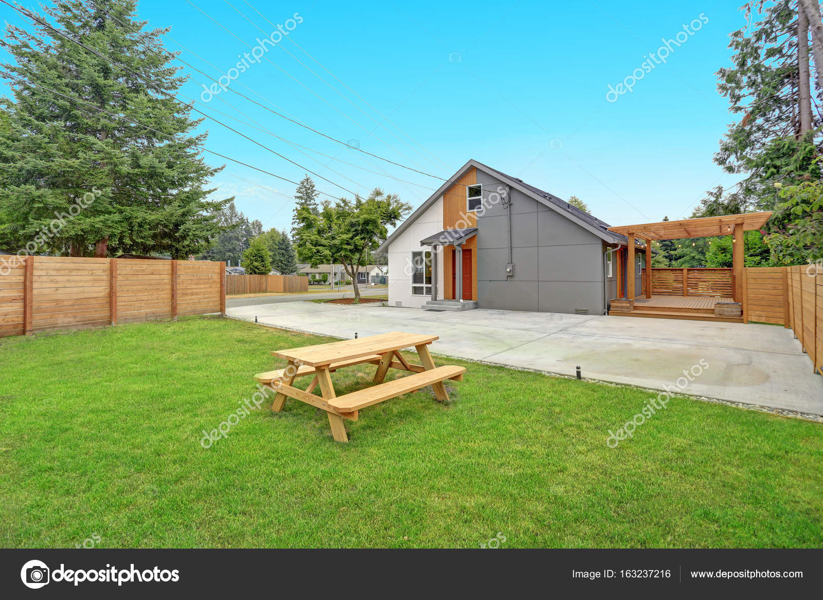 Completely renovated modern home in everett wa view of the back yard with spacious concrete patio area and large wrap deck photo by alabn