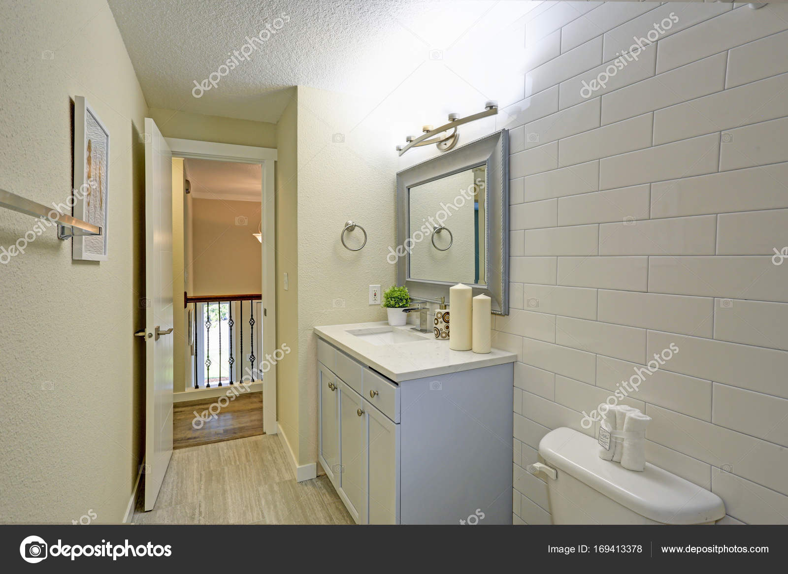 Freshly renovated bathroom features light blue bathroom vanity stock photo