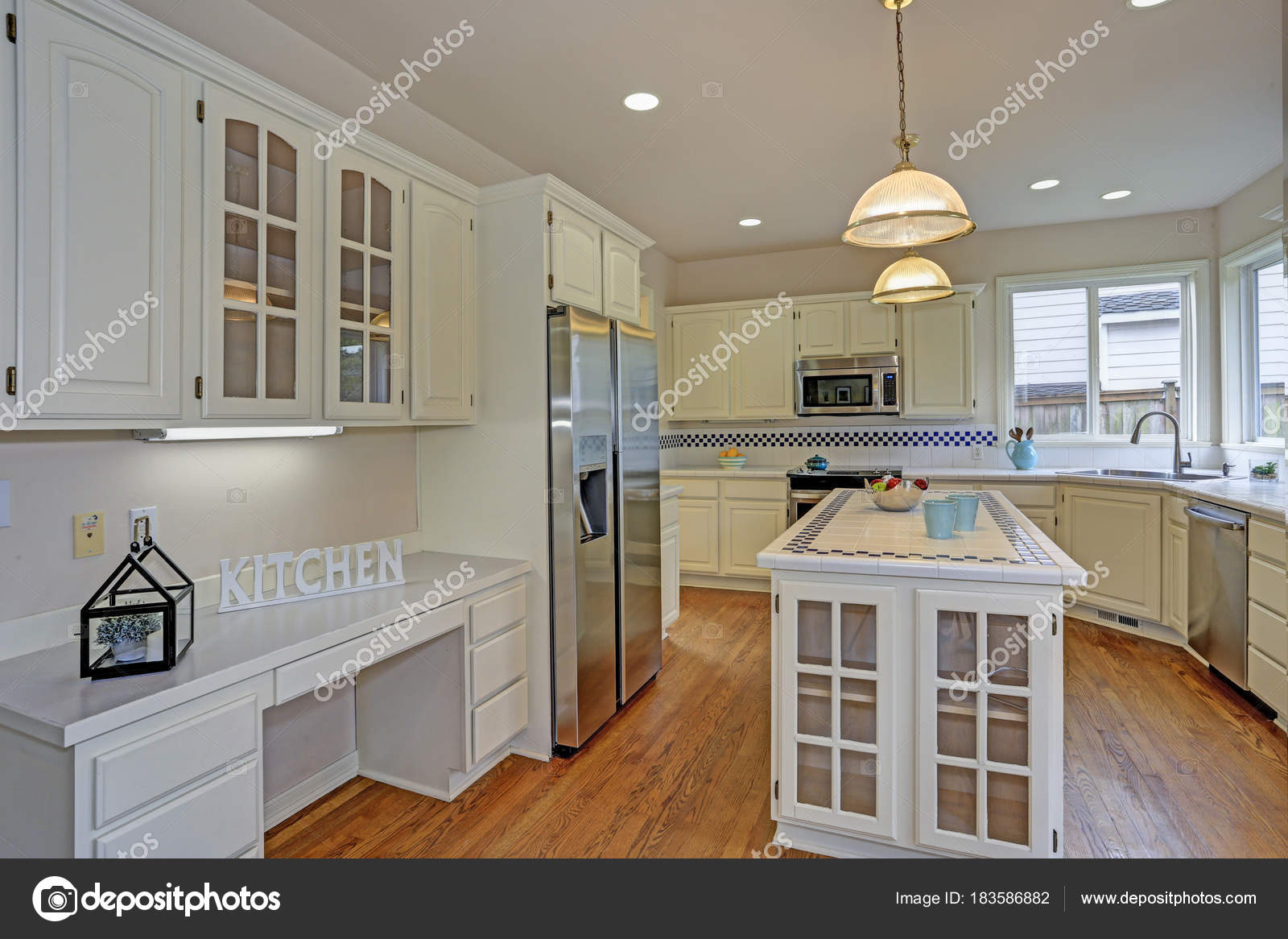 Open White Kitchen Interior With Kitchen Island Stock