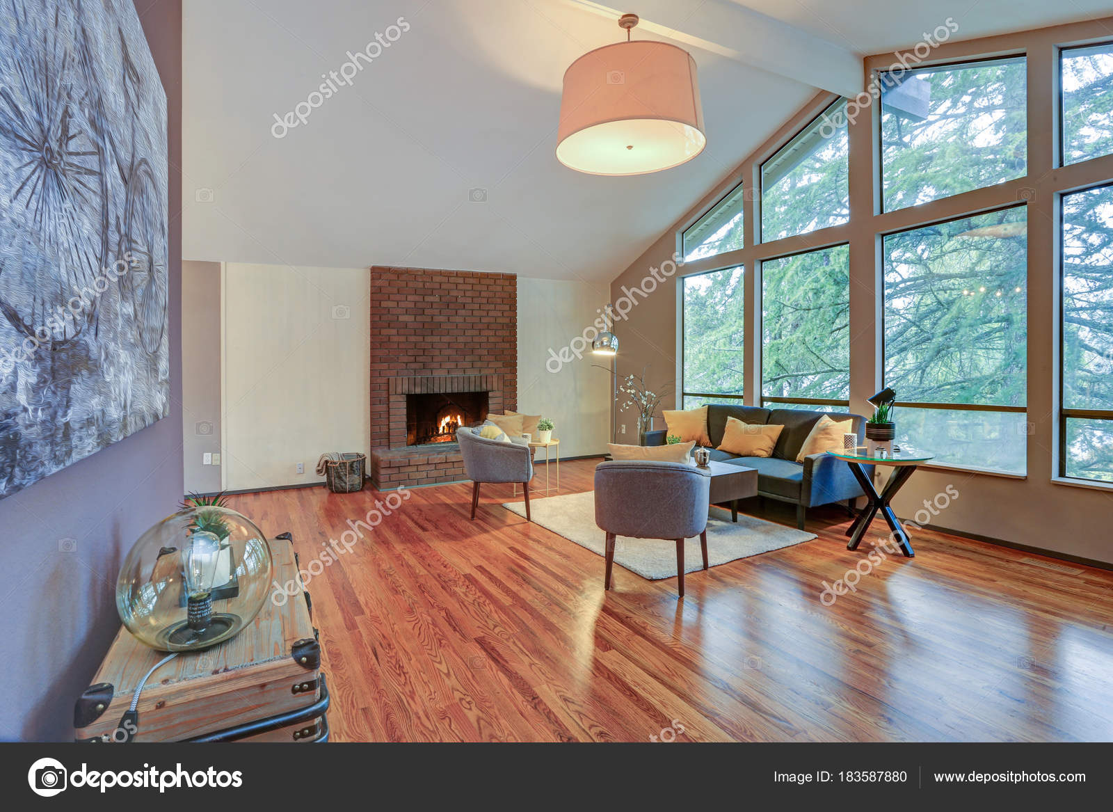 Lovely Spacious Open Floor Plan With Vaulted Ceiling And Tan Walls Features Living Room Window Wall Brick Fireplace Polished Hardwood