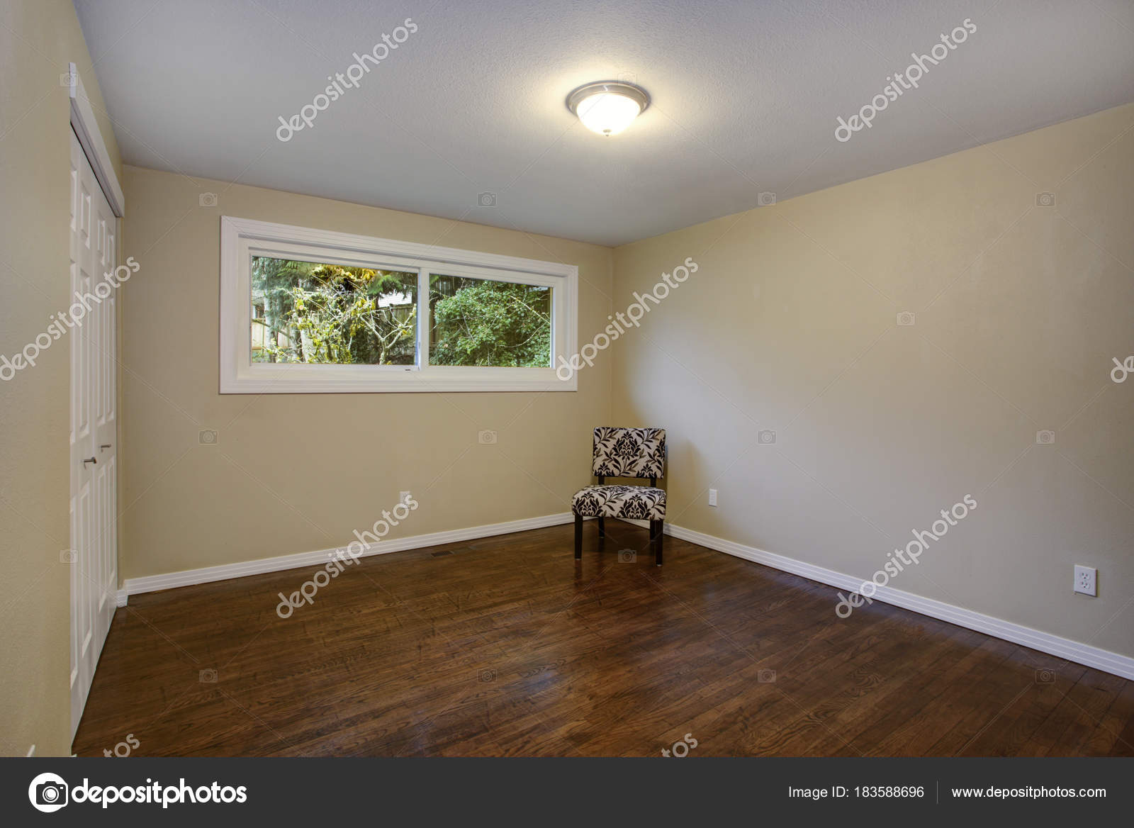 Empty Room Taupe Walls Hardwood Floor In A Luxury Home Stock Photo