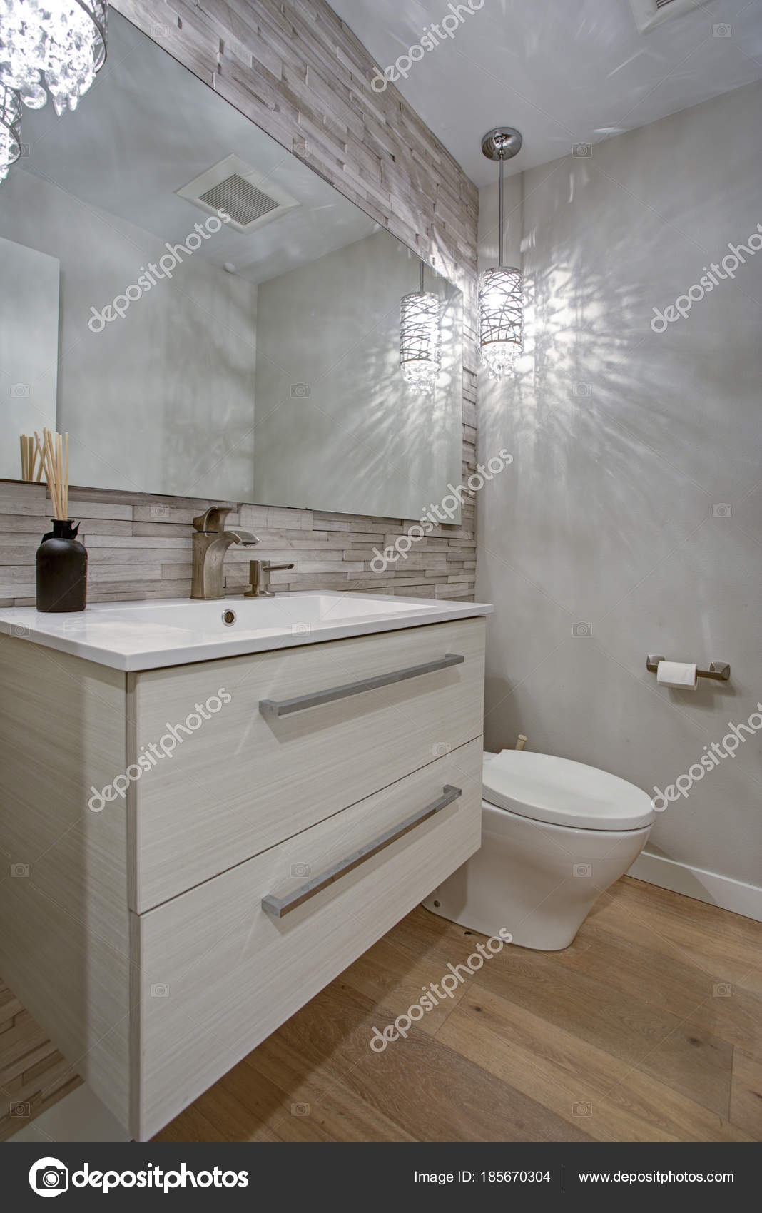 - Contemporary Bathroom Design With Taupe Linear Tiles Accent Wall
