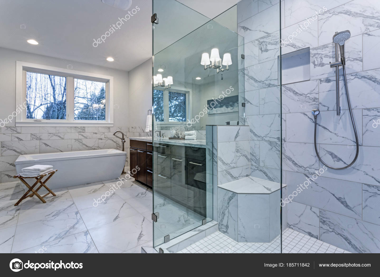 Incredible master bathroom with Carrara marble tile surround ...