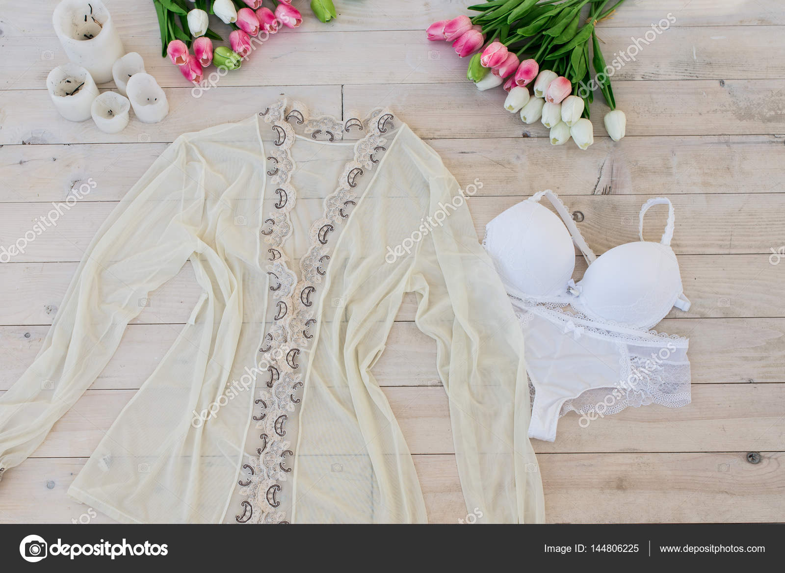 Women\'s white lingerie with dressing gown — Stock Photo © yana.b ...