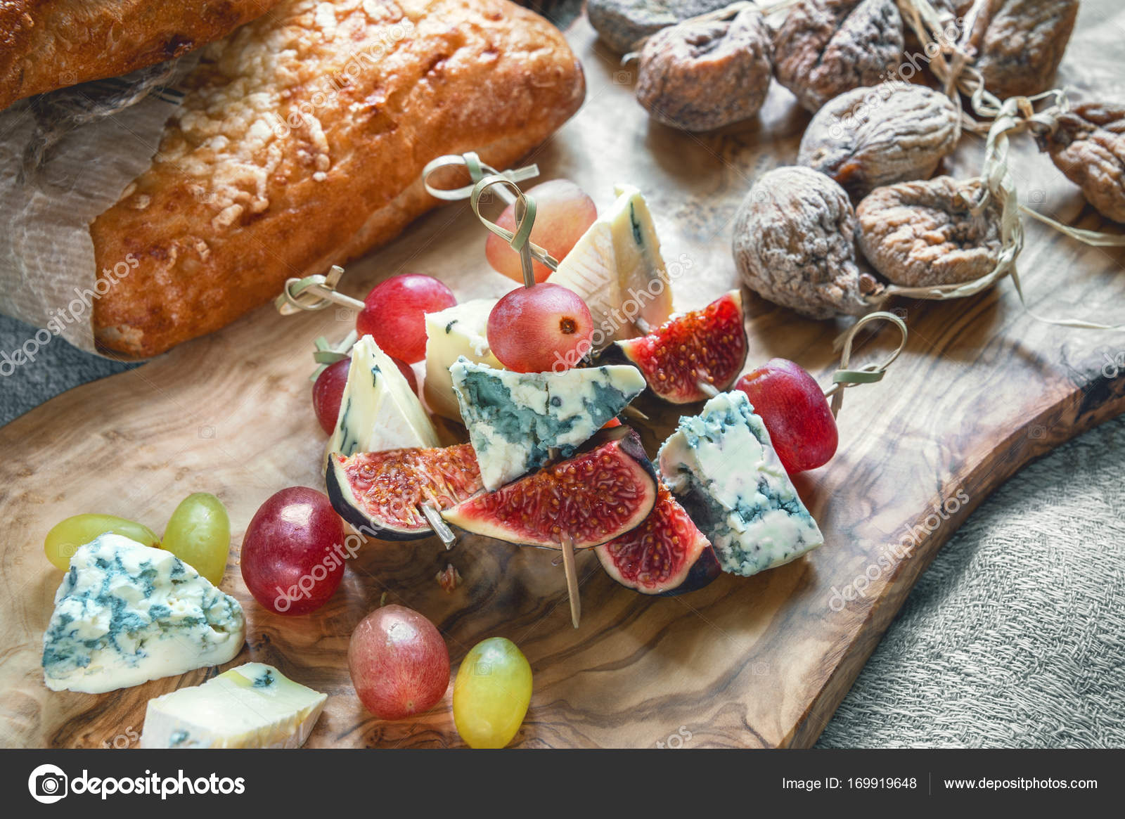 Italian Focaccia bread with cheese and a cheese plate with figs and Gorgonzola brie & Italian Focaccia bread with cheese and a cheese plate with figs and ...