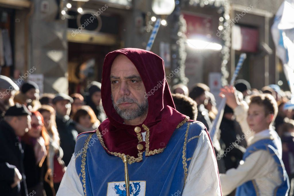 Men in medieval costume at traditional parade of Epiphany Befana medieval festival in Florence, Tuscany, Italy.