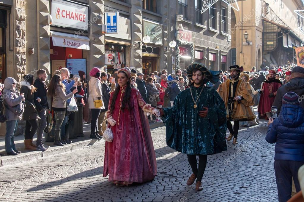 Man and woman in medieval costume at traditional parade of Epiphany Befana medieval festival in Florence, Tuscany, Italy.