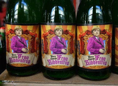 Bottles of beer featuring Chancellor of Germany Angela Merkel on label named