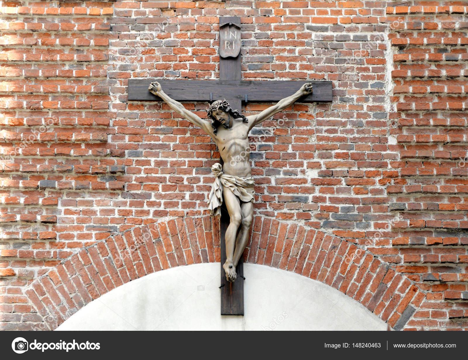 Crucifix on brick wall jesus christ on cross religious belief crucifix on brick wall jesus christ on cross religious belief and hope holy and sacred places photo by bumble dee biocorpaavc