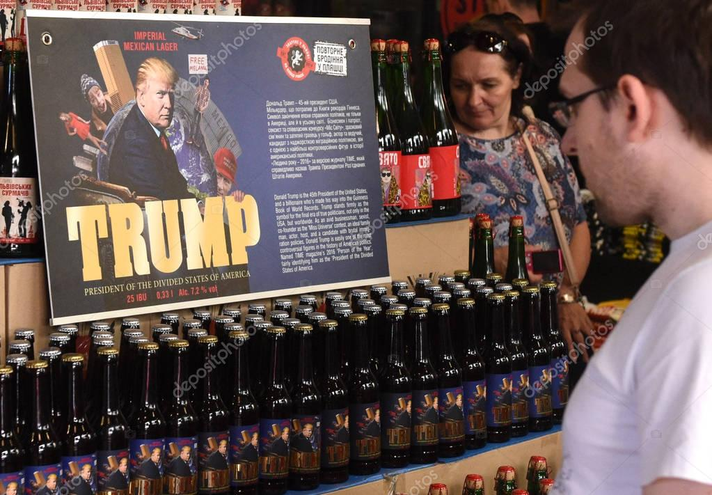 Customers look at bottles of beer featuring US President Donald Trump called Trump in