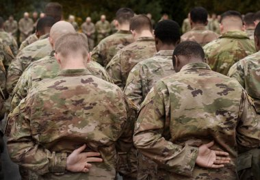 US soldiers. US army. US soldiers pray. Military of USA.