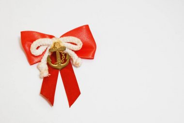 Nice handmade bow with miniature of metal anchor