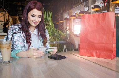 Girl with  mobile and credit card