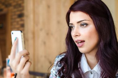 woman  talking on the phone with video call