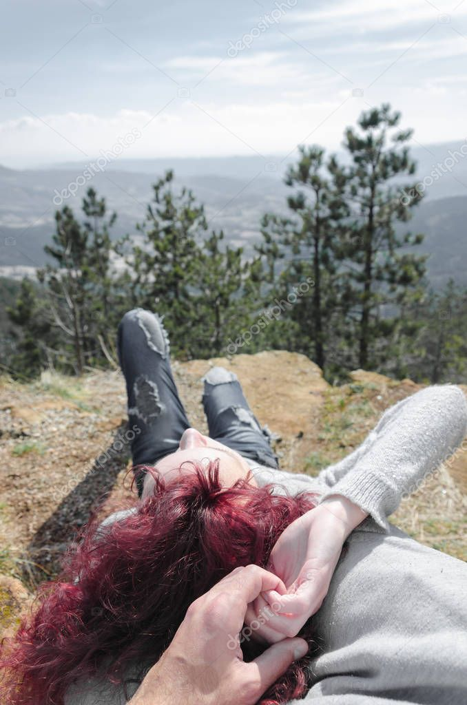 Girl lies with the boy enjoy the landscape