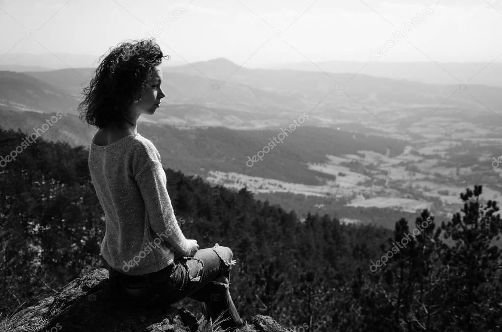 girl enjoying on the mountain
