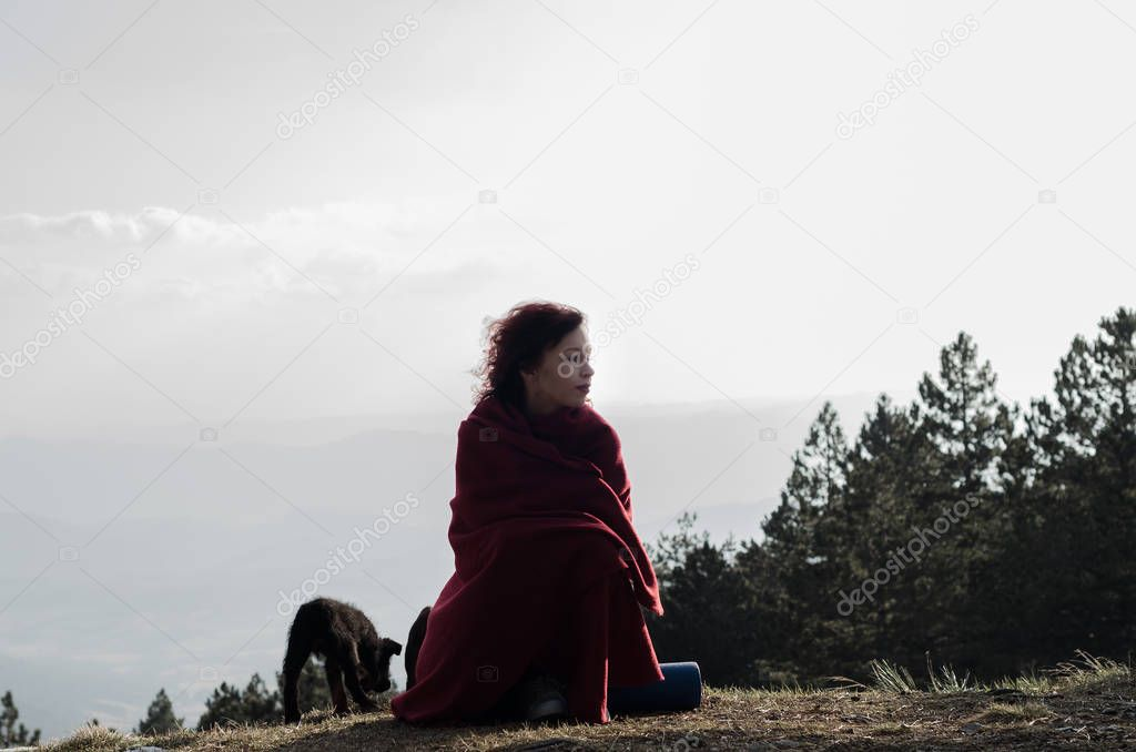 Girl and dog on the mountain