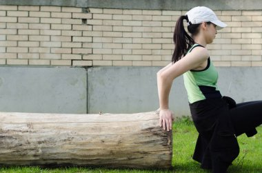Girl in sports clothes doing exercises