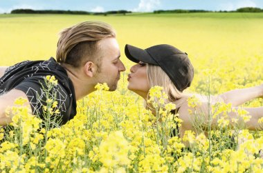 husband and wife enjoyed in the flowers field