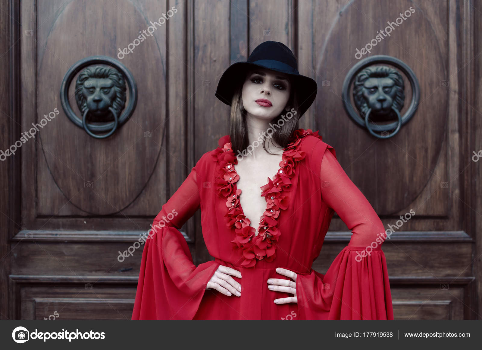 Beautiful young fashionable woman posing in red dress and black hat.– stock  image 475a0a473b7