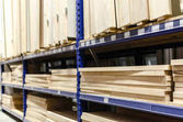 Photo Stacked wood pine timber for furniture production and construction,selective focus and space for text