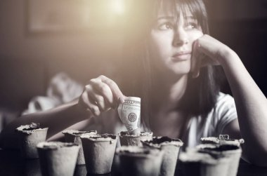 Young beautiful woman plant money in recycling pots, Saving and growth  money concept