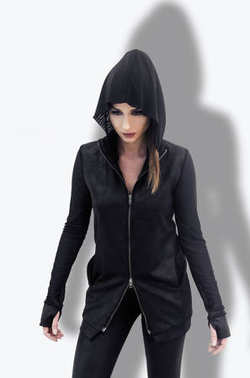 portrait of a modern young woman in modern black design coat