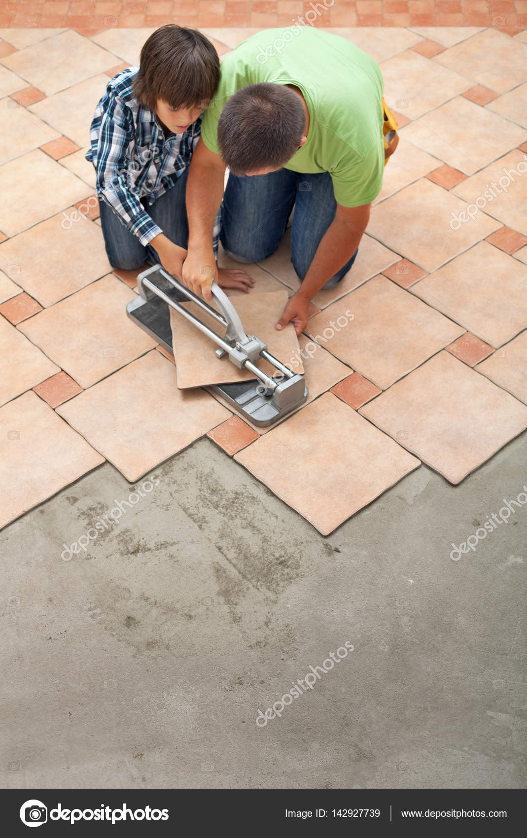 Young Boy Learning How To Cut A Ceramic Floor Tile Stock Photo