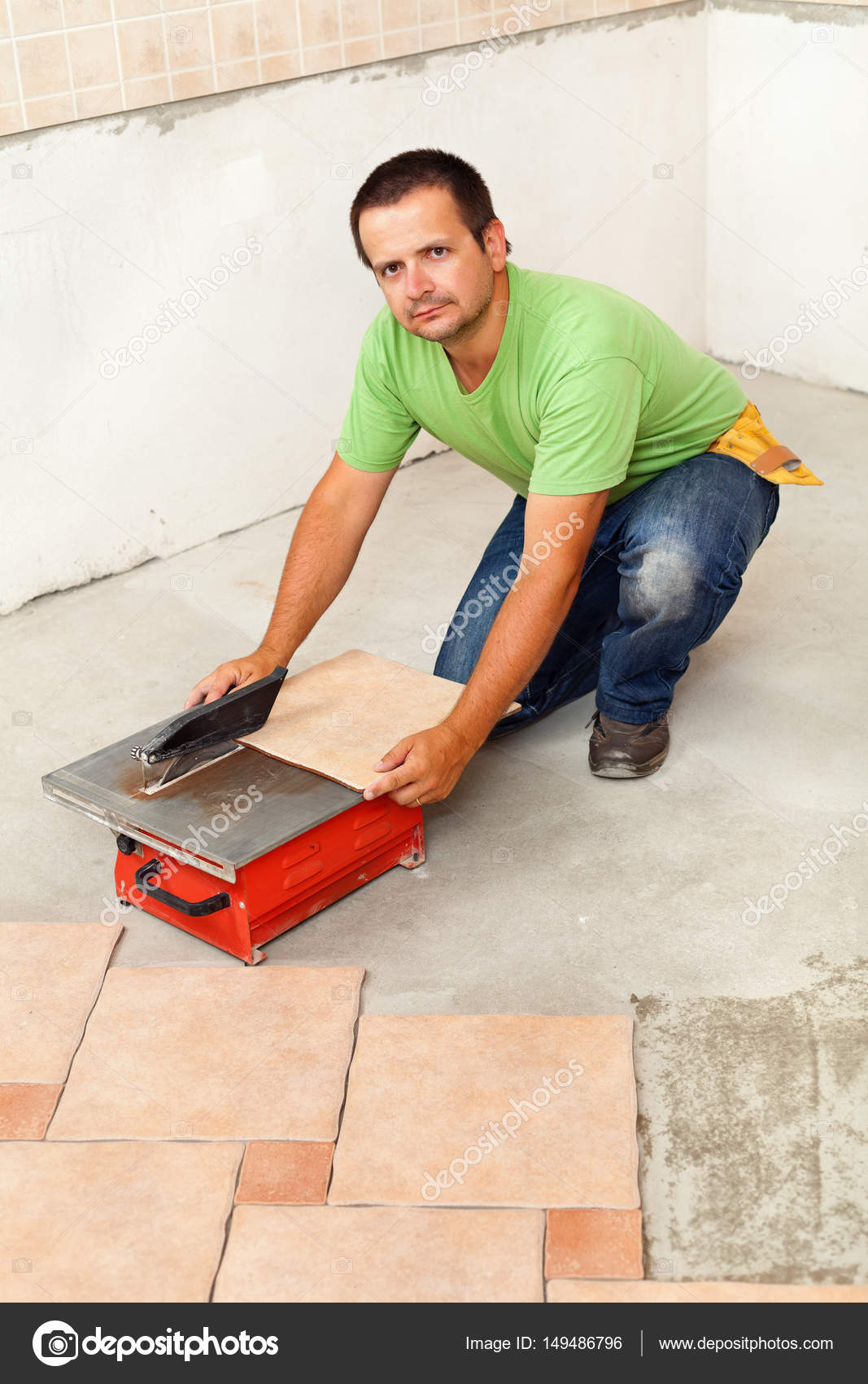 Man cutting ceramic floor tiles with electric cutter stock photo man cutting ceramic floor tiles with electric cutter stock photo dailygadgetfo Image collections