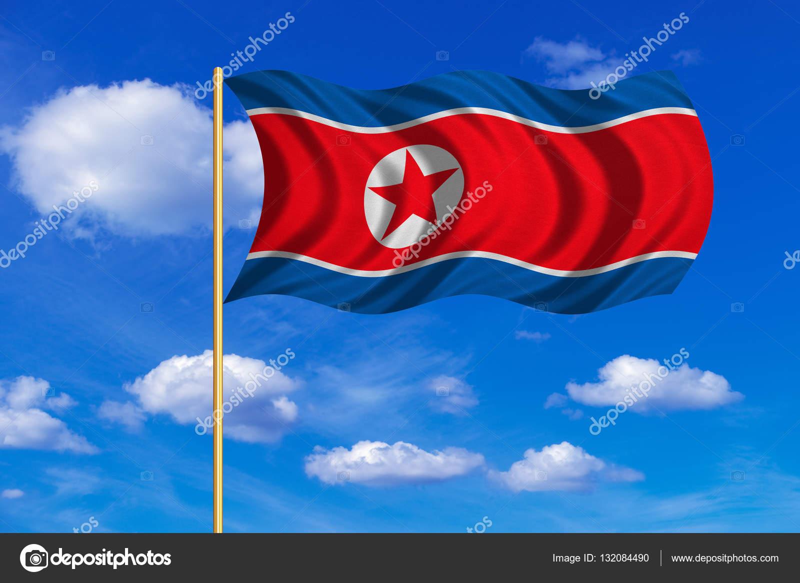 Flag Of North Korea Waving On Blue Sky Background Stock Photo