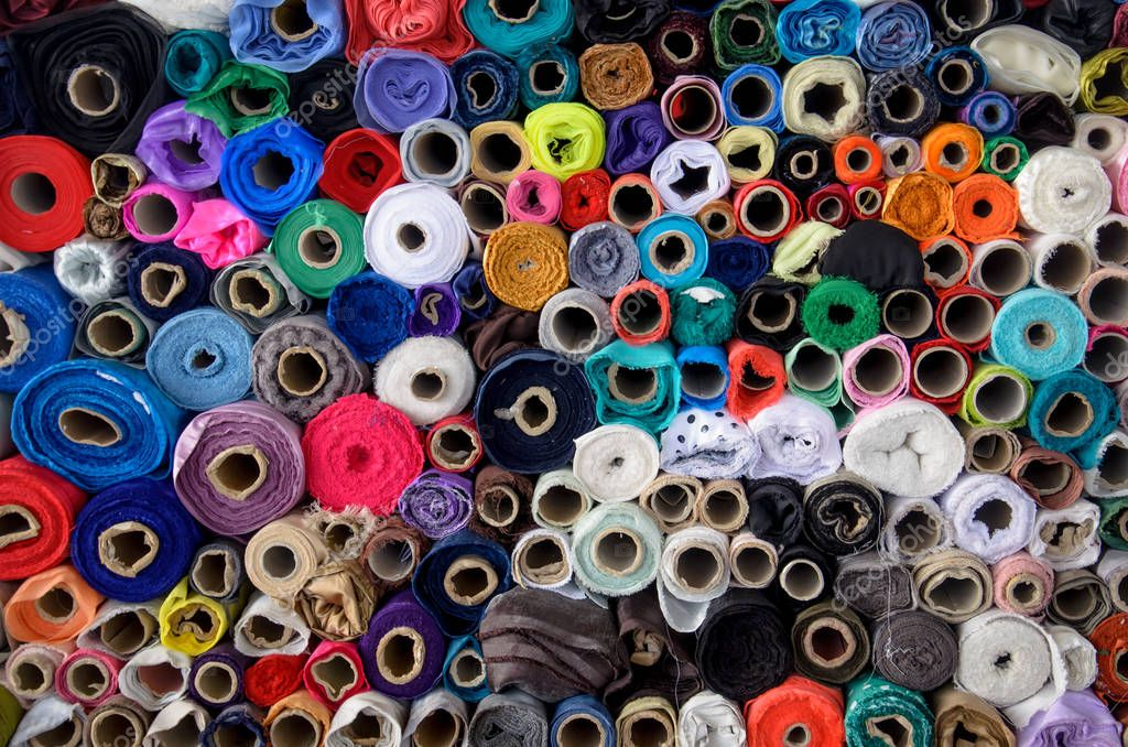 Rolls of cloth on the market with different colors