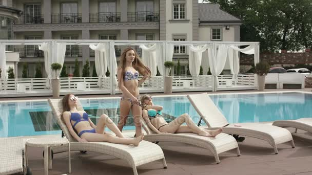 Young Girls Relaxing At The Pool