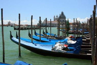 Gondolas and Basilica Santa Maria della Salute on the Grand Canal in Venice. Italy. July, 2007.