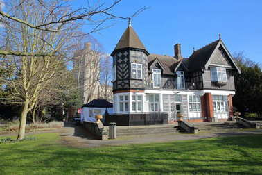 LONDON, UK - FEBRUARY 18, 2018: Pryor's Bank, a Gothic House in Fulham, Bishops Park, borough of Hammersmith and Fulham. With the tower of All Saints Church in the background