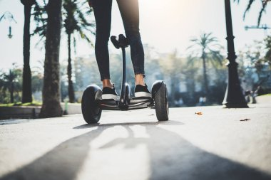 girl balancing on electric hoverboard