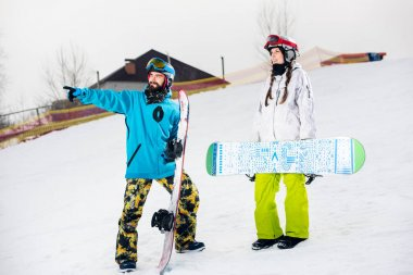 Young couple of snowboarders