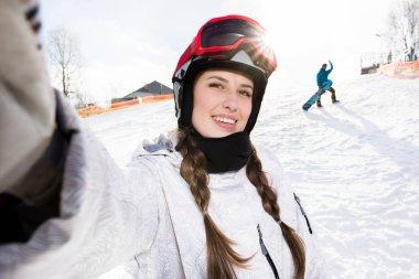 Snowboarder taking selfie