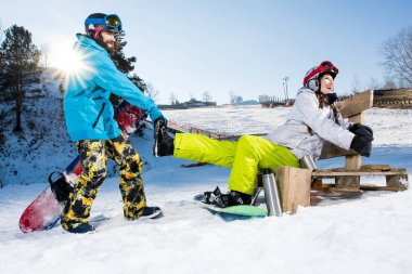 Snowboarders fooling around