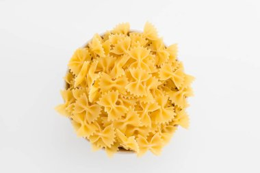 Uncooked macaroni in plate