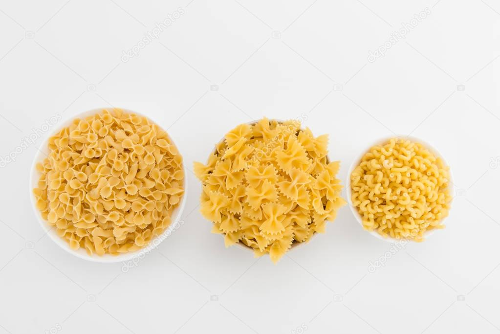 Raw italian macaroni in plates