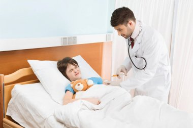 Pediatrician and patient in hospital