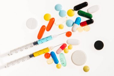 Medical pills and syringes