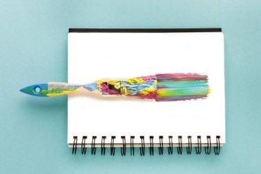 Brush and colorful brushstroke
